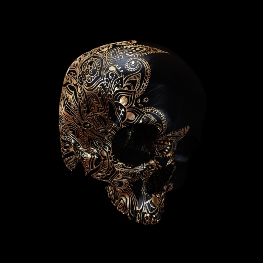 Copper skull with paisley patterns etched into it